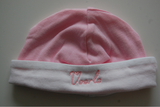 babymuts roze met witte rand