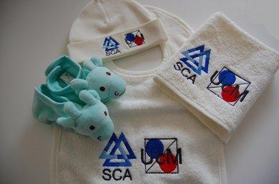Kraamcadeau met (bedrijfs)logo verpakt in Luxe Baby Kadotas